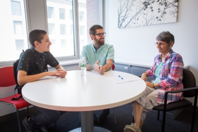 Supervisor having meeting with two coworkers