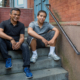 father and son sitting on stoop